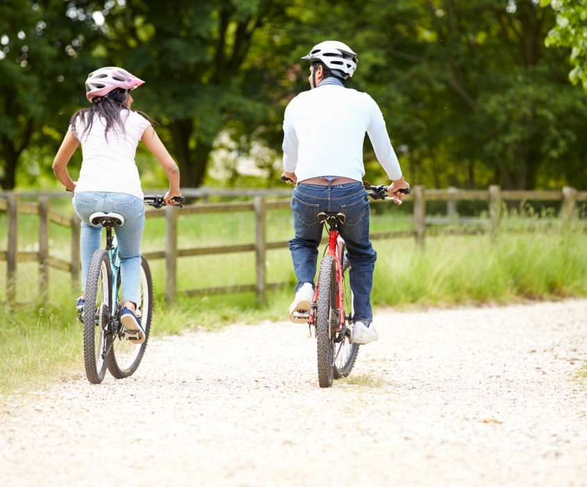 Adventures Cycling Couple on Cycle Ride in Countryside
